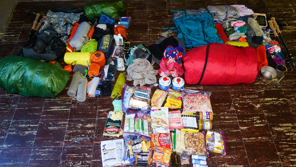 gear and food laid out on the floor for a backpacking trip