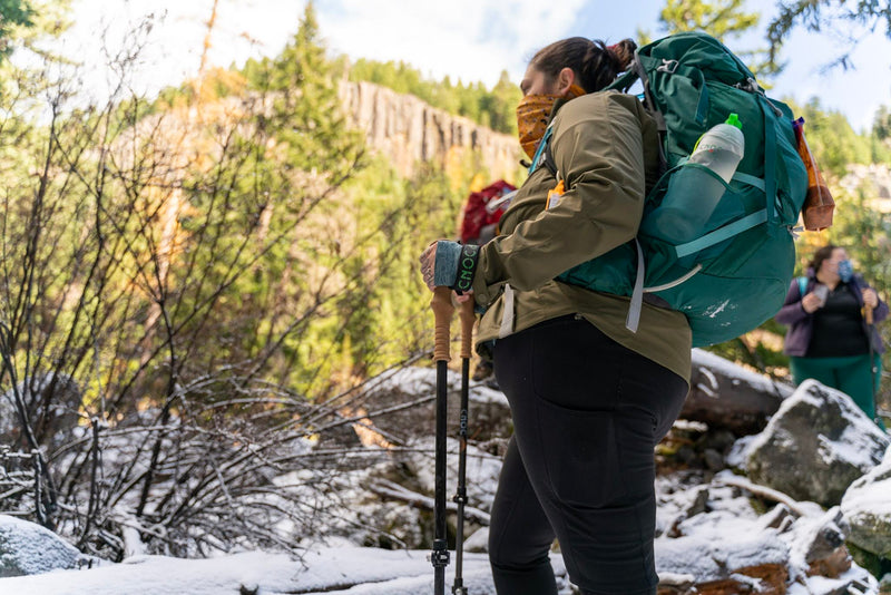 Woman on a hike with Cnoc Outdoor Trekking Poles.