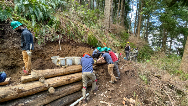 The Cnoc Team volunteering with Trail Keepers of Oregon to build a crib wall on part of the Oregon Coast Trail