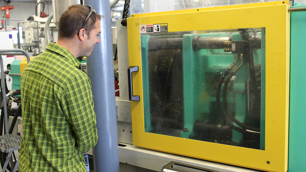 Gilad looks in on a manufacturing process