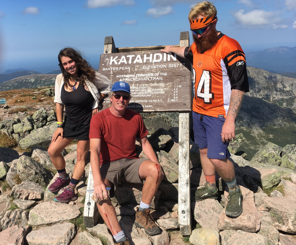 Hiking Sailor with other hikers at Katahdin sign