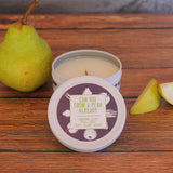 """Get a Whiff Co.'s """"Can You Grow a Pear Already"""" candle sitting open on a table with pear slices next to it."""