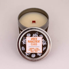 """Get A Whiff Co.'s """"Amber Management Class"""" mini candle."""