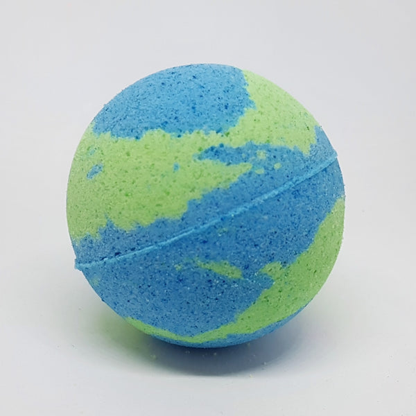A round bath bomb that is green and blue