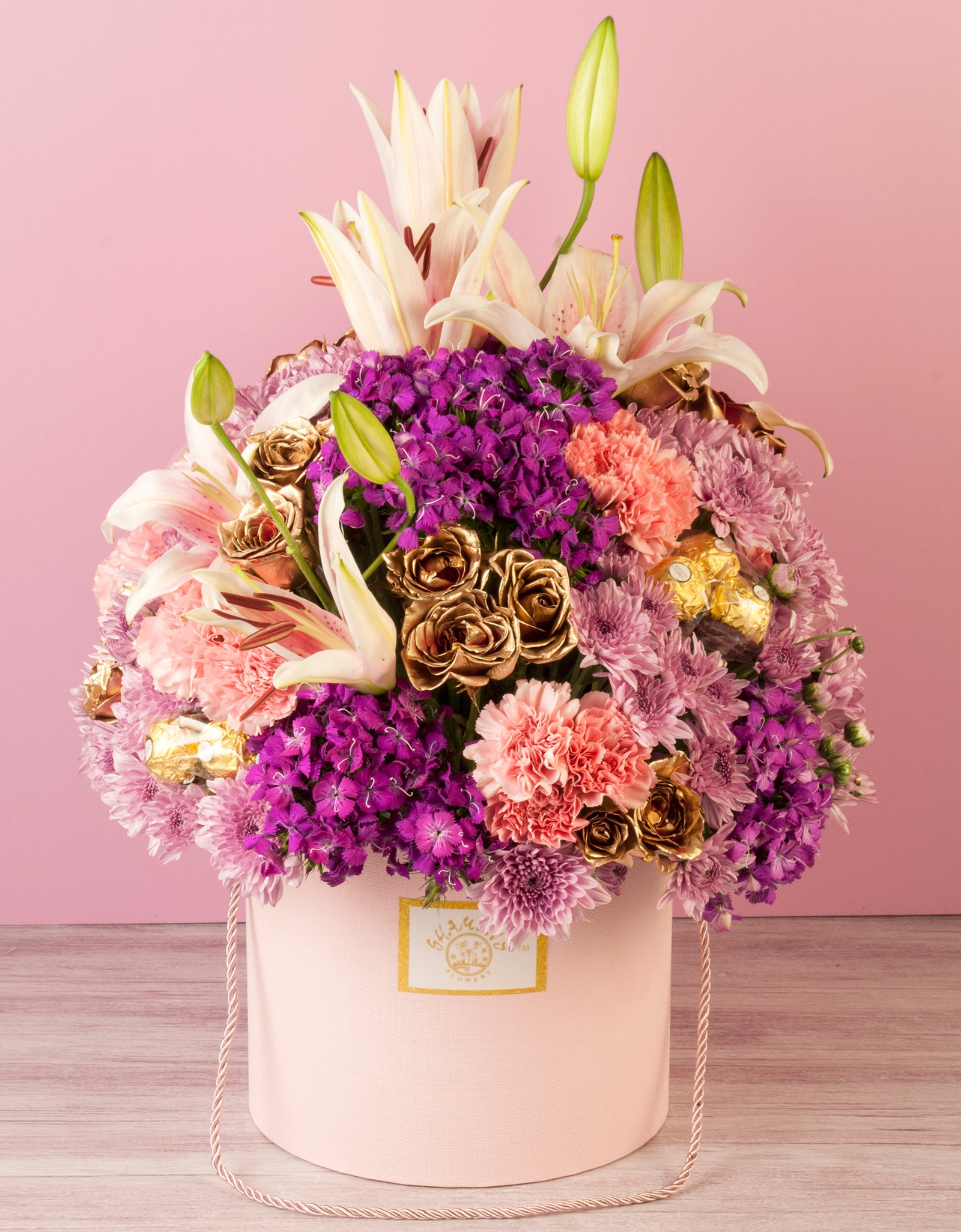 Pink And Purple Flowers In A Hat Box