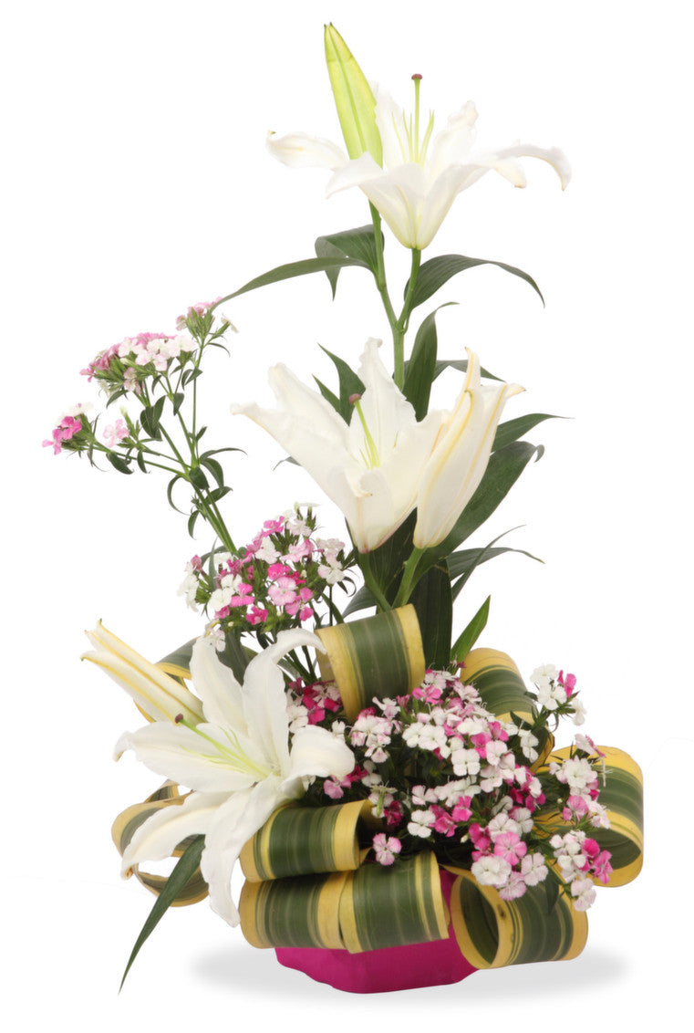 White lilies arranged in a basket with seasonal fillers shamuns online order flowers izmirmasajfo