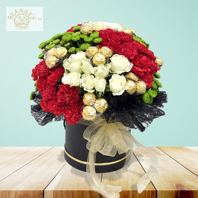 Hat Box with mix flowers and Chocolates