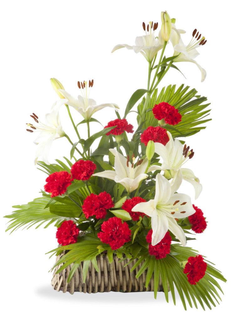 Lilies And Carnations Arranged In A Basket