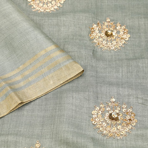 Handwoven pastel green Tussar silk Saree with zari stripped border