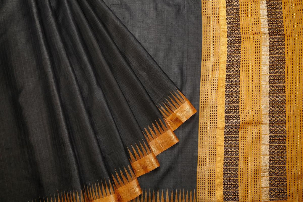 Sambalpuri Ikkat Tussar Silk Black Saree With Orange Temple Border