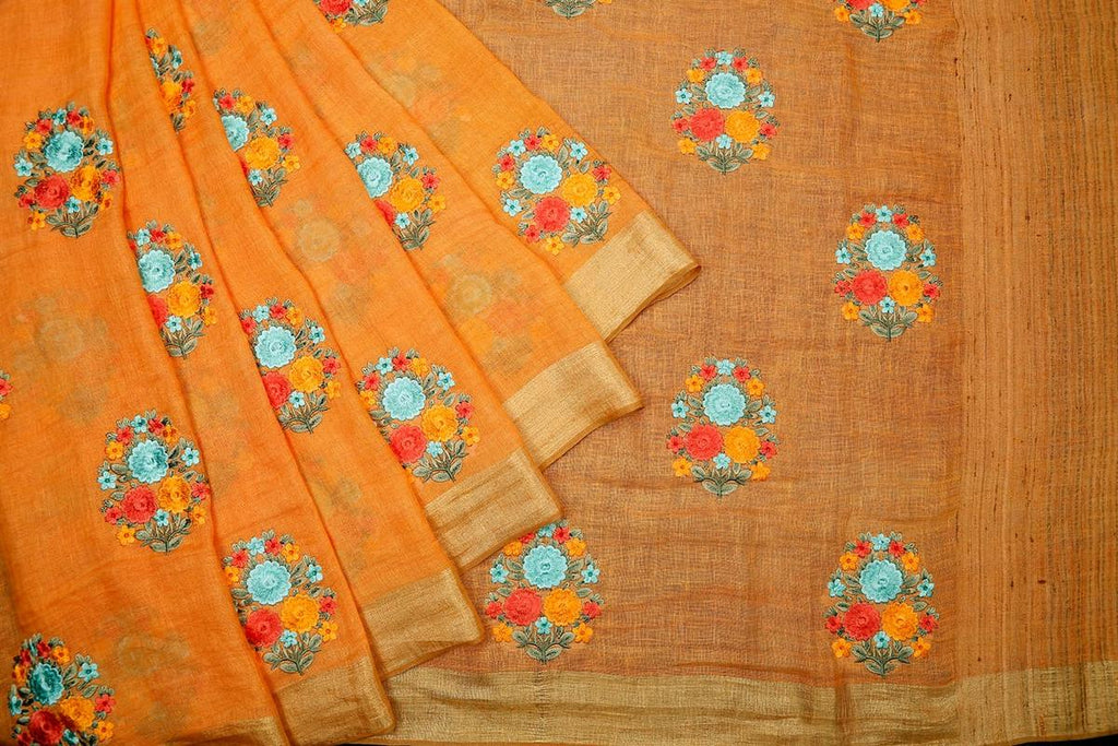 handloom orange linen Saree with embroidered thread work of flowers