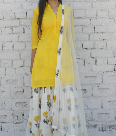 printed  yellow  and off white base mulmul sharara set
