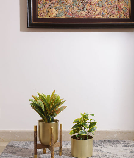 Metal Planter On Wooden Stand In Brass Finish