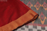 black and maroon Ikkat kora silk Saree with red and orange zig zag pattern