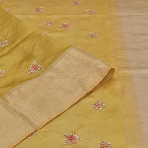chanderi golden Saree with small mustard and red colour thread flowers Motif