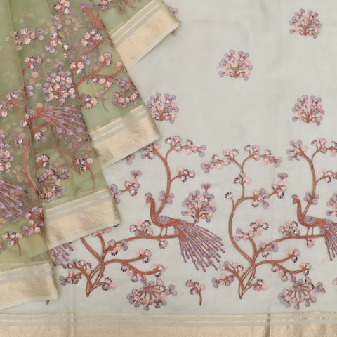 organza silk green Saree with all over flower motifs and peacock motifs