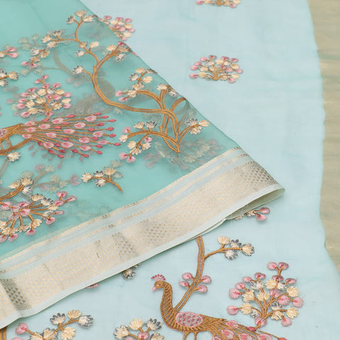 organza silk light greenish Saree with all over flower and peacock motifs