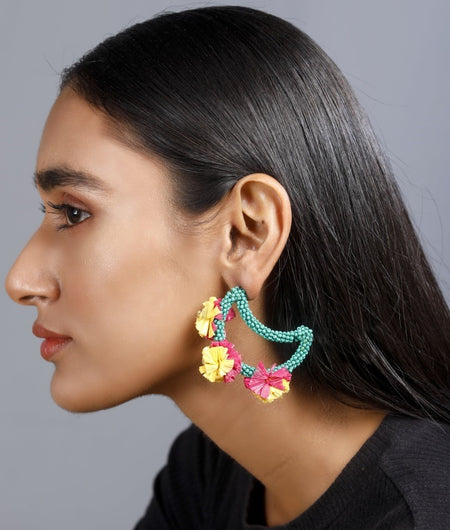 Moon shaped earrings with multi-coloured raffia work