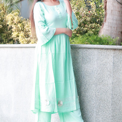 Beautiful sea green suit set with bell sleeves with Hand Block Work
