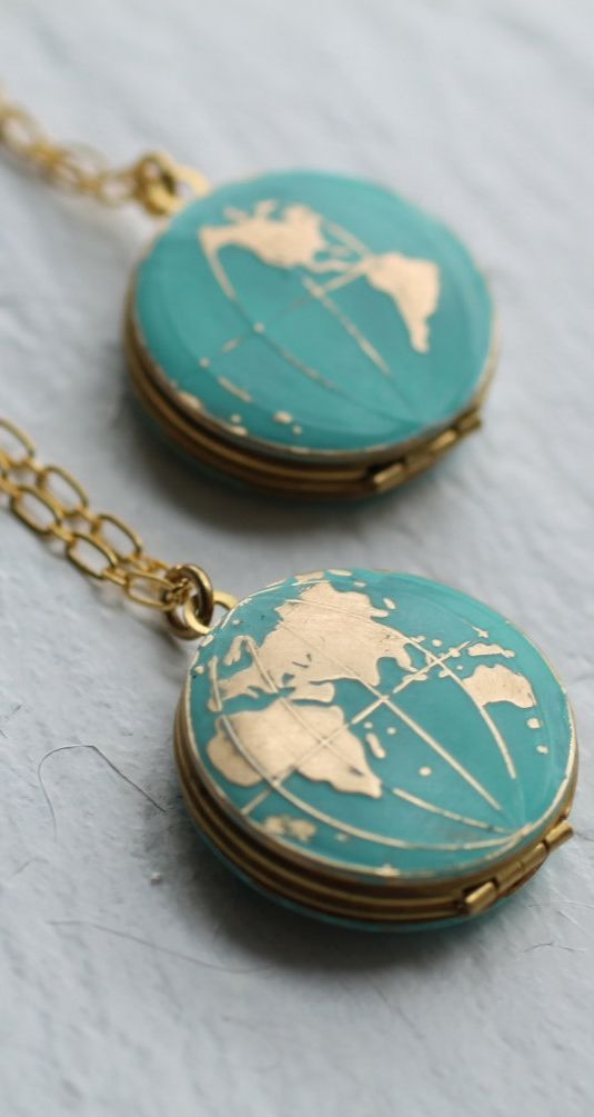 This world map globe locket is vintage brass, which has been carefully hand enamelled to turn the ocean