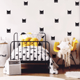 black and white kids room with touch of yellow and black bat masks wall stickers on the wall