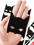single black bat mask displayed on the hand