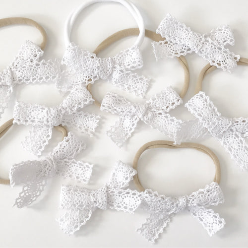 Eyelet Bow On a Headband or Clip