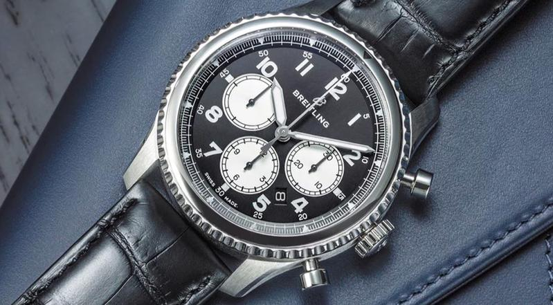 Which brand is more prestigious, TAG Heuer or Breitling?