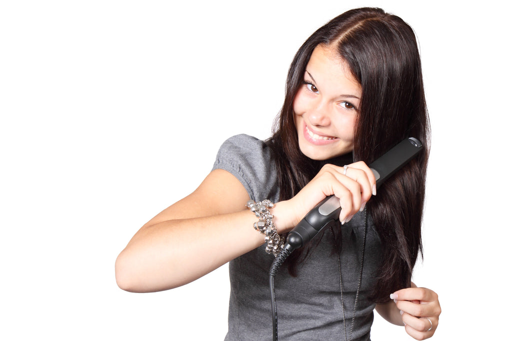 Ceramic Vs. Titanium Flat Irons - Benefits and Risks To Natural Hair