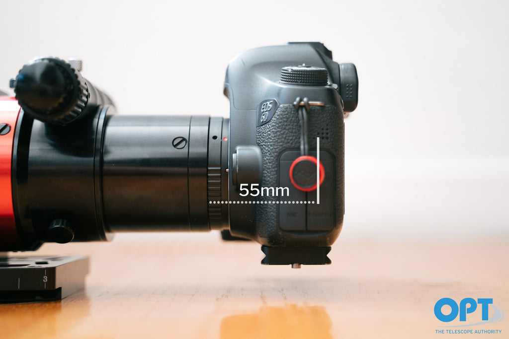 A Canon DSLR attached to a telescope with a back focus of 55mm.