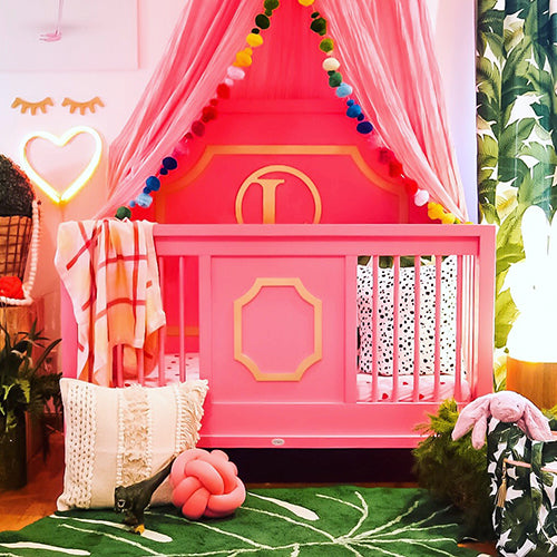 Carmen Shalene (Carmen the Modern Mom) pink and green toddler room.