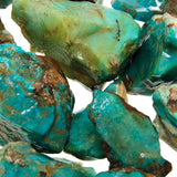 Close up photo of Gem Silica Rough - a bluish green chalcedony colored by copper.