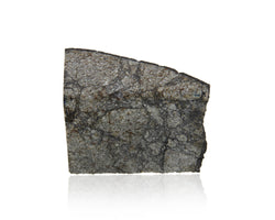 The Peekskill meteorite is an H6 monomict breccia; its filigreed texture is the result of the shocking and heating following the impact of two asteroids in outer space.