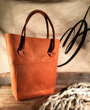 handcrafted orange leather tote