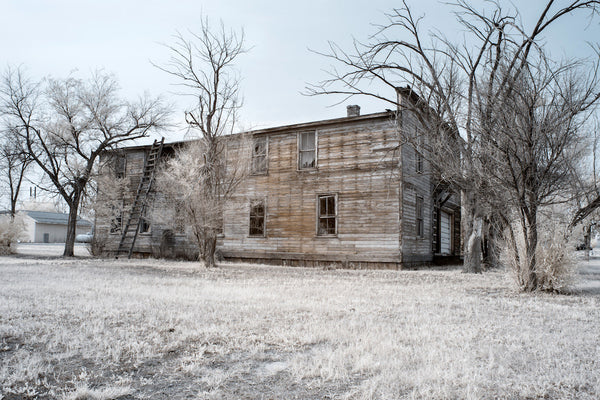 A photo of a house in a state of decay and ruin. Photo is a free high resolution stock image to use any way you choose.