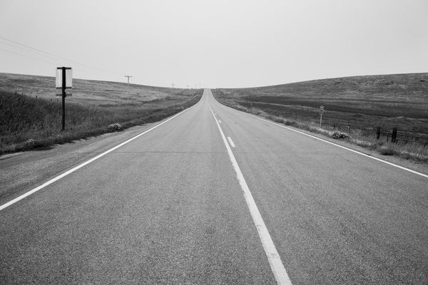A photo of an empty highway road in black and white. Photo is a free high resolution stock image to use any way you choose.