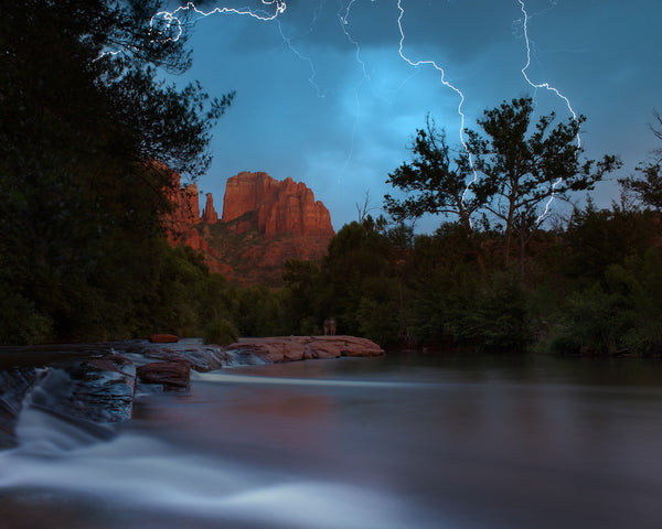 A photo of a lightning storm by a lake in Sedona Arizona. Photo is a free high resolution stock image to use any way you choose.