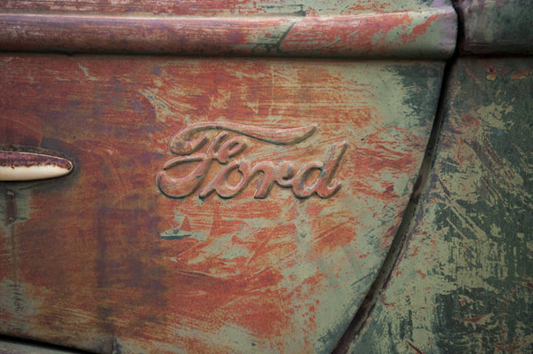 A photo of a rustic panel from an old Ford vehicle. Photo is a free high resolution stock image to use any way you choose.