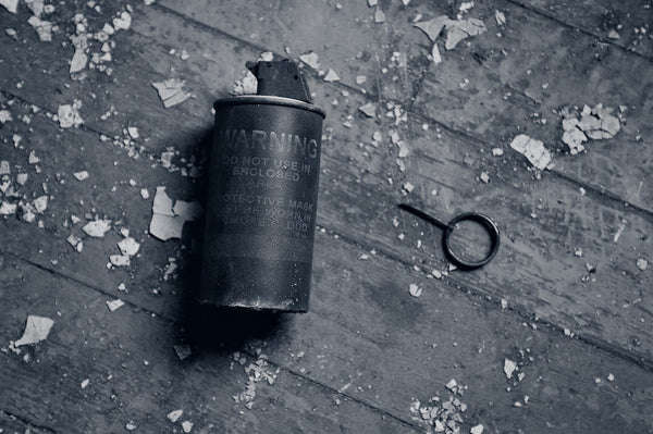A photo of a used smoke bomb in black and white. Photo is a free high resolution stock image to use any way you choose.