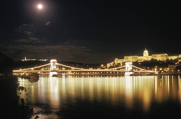 A photo of a bridge at nighttime in Budapest. Photo is a free high resolution stock image to use any way you choose.