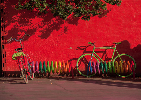 A photo of bicycles in a colorful bike rack. Photo is a free high resolution stock image to use any way you choose.