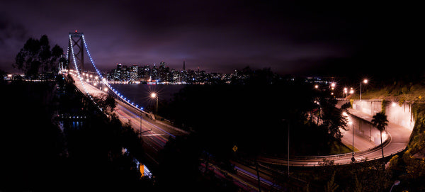 A panorama photo of the Bay Bridge at night. Photo is a free high resolution stock image to use any way you choose.