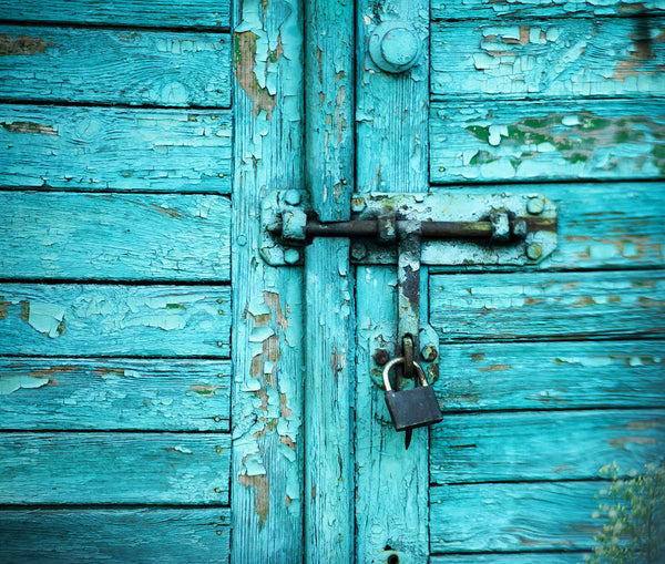 A photo of a blue door with a lock on it. Photo is a free high resolution stock image to use any way you choose.
