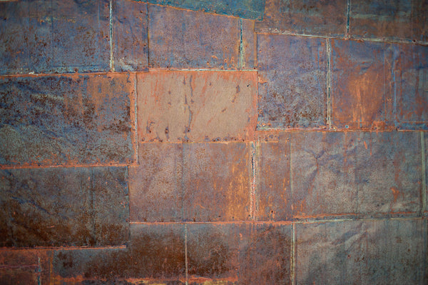 A photo of a tiled flooring with rusted colors. Photo is a free high resolution stock image to use any way you choose.