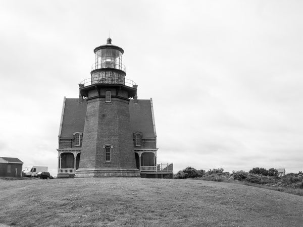A photo of a lighthouse on Block Island in black and white. Photo is a free high resolution stock image to use any way you choose.