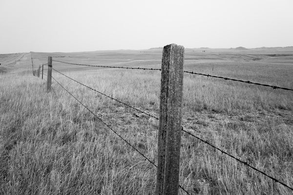 A photo of a fence on the way to Montana shot in black and white. Photo is a free high resolution stock image to use any way you choose.