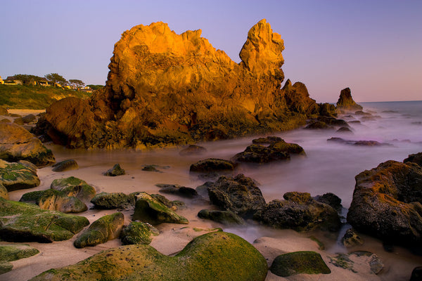 A photo of at sunset in a rock cove by the beach. Photo is a free high resolution stock image to use any way you choose.
