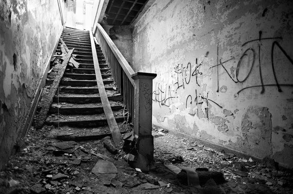 A photo of a abandoned staircase shot in black and white. Photo is a free high resolution stock image to use any way you choose.