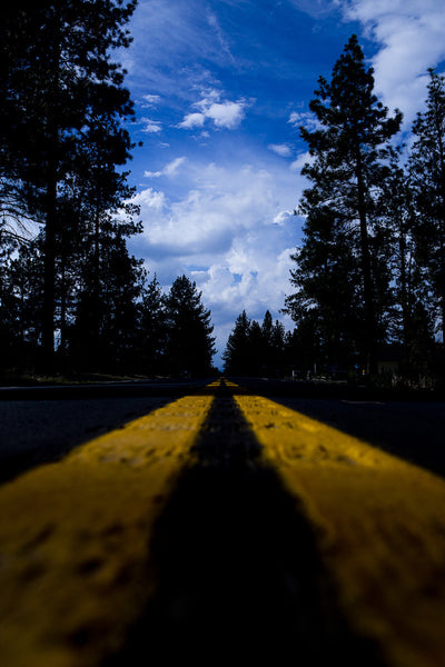 A photo of a road from the point of view of driving down it. Photo is a free high resolution stock image to use any way you choose.