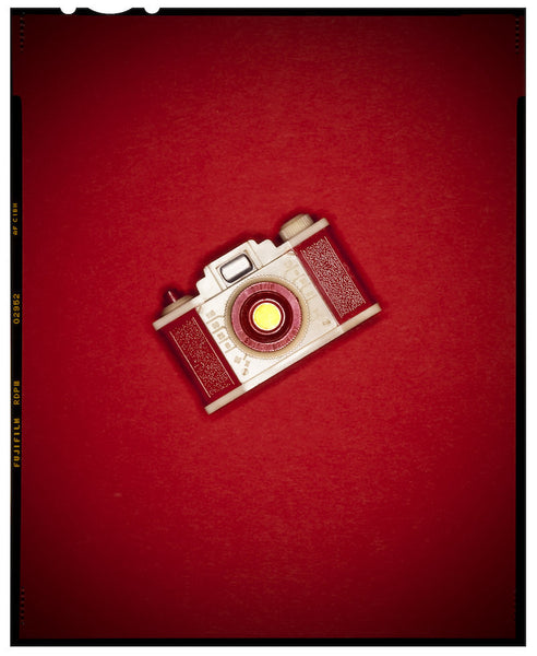 A photo of a camera in red. Photo is a free high resolution stock image to use any way you choose.